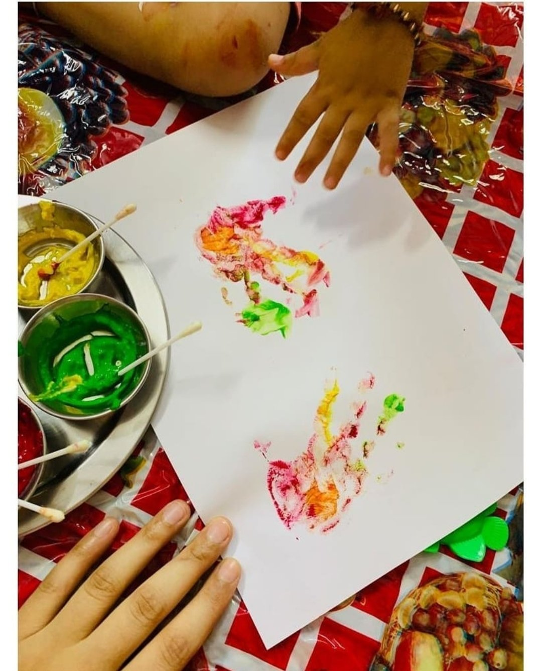 Hand prints using edible finger paints